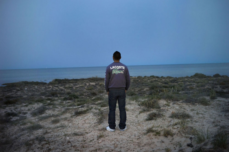Zarzis, Tunisia, April 2011. Oussama,19, avril 2011., is a candidate for illegal immigration to France*, through Lampedusa in Sicilia. He is posing at the place where he will embarq very soon.  by Patrick Zachmann / Magnum Photos